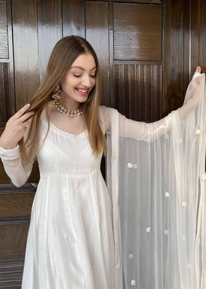 White Frock With Embroidered Floral Dupatta and Churidaar Pajama