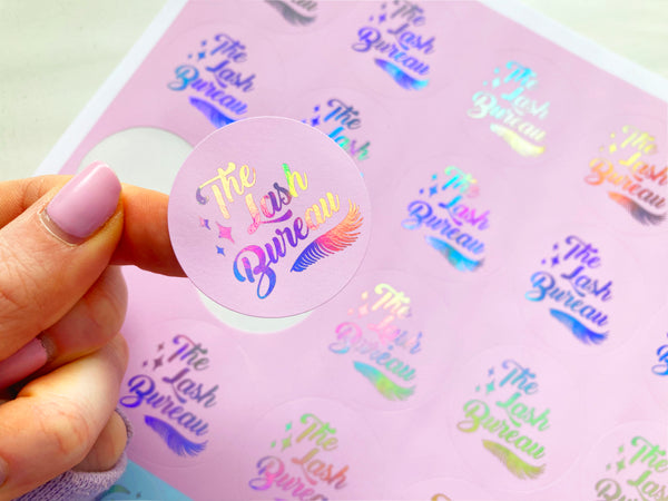 custom logo stickers with holographic foil and coloured pink background. available in a range of foil colours with your personalised business logo.