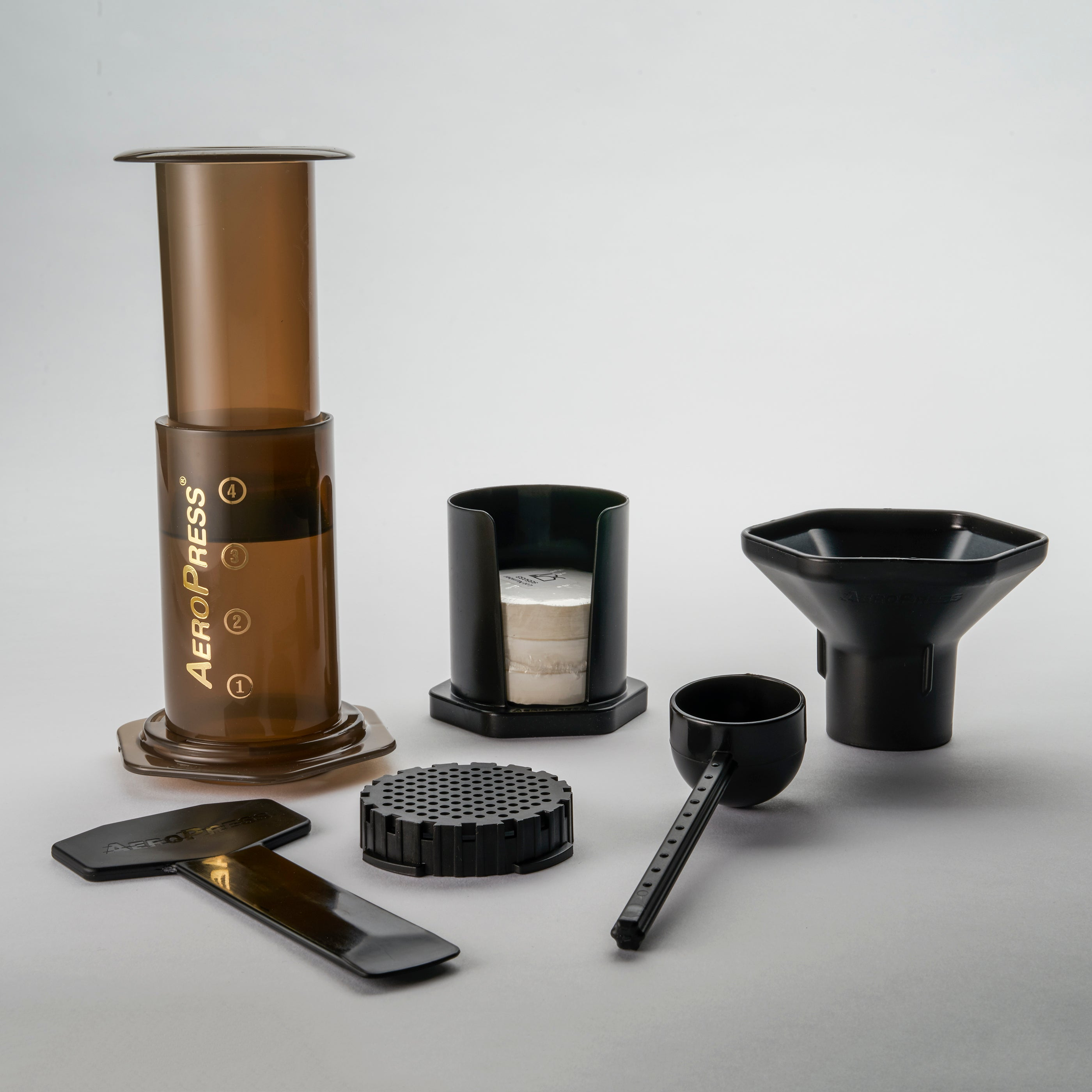 The Aeropress kit with the device, filters, funnel, strainer and scooper.
