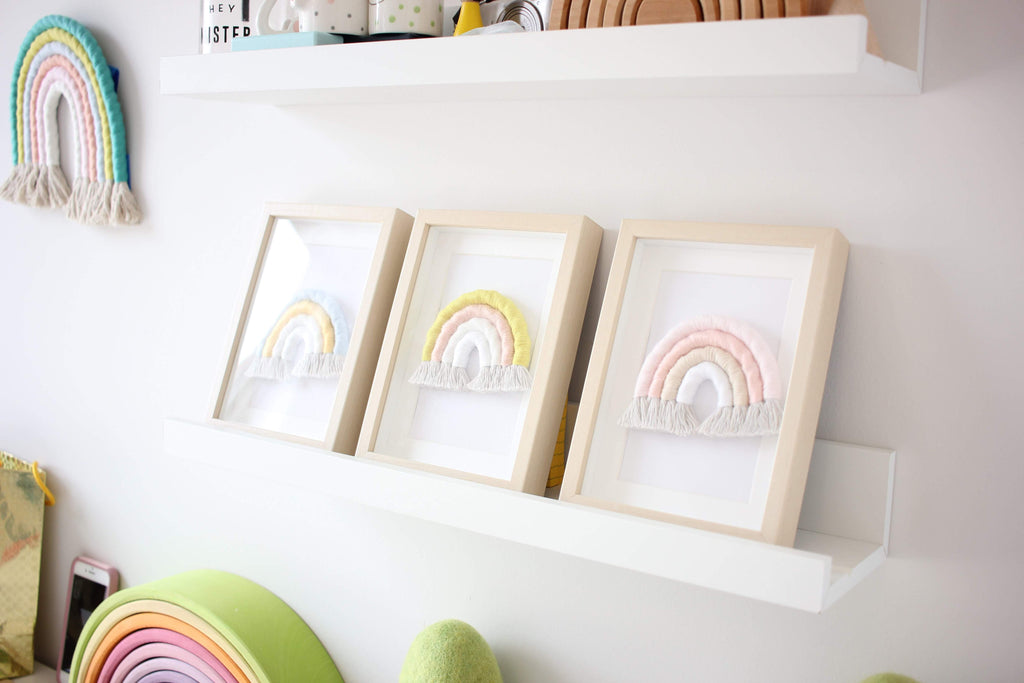 Three baby rainbows in IKEA frames