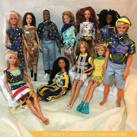 A collection of Barbie dolls wearing Anke Wonders outfits as miniature versions.