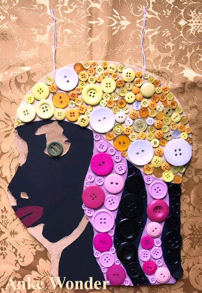 Button Artwork shows the head of a black woman made out of yellow and pink buttons by designer Anke Wonder.