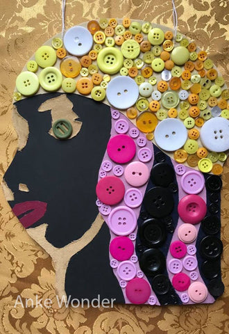 Button Artwork that shows the head of a black woman, completely made out of buttons by designer Anke Wonder.