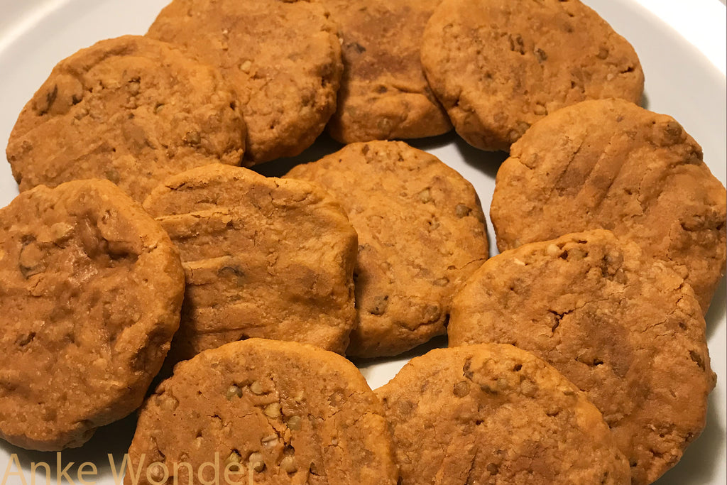 Vegan cookies made with peanut butter and raisons, making them a healthy Christmas treat.