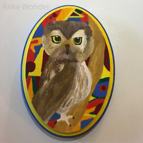 Painting of a brown owl sitting on a tree with colorful background by Anke Wonder.