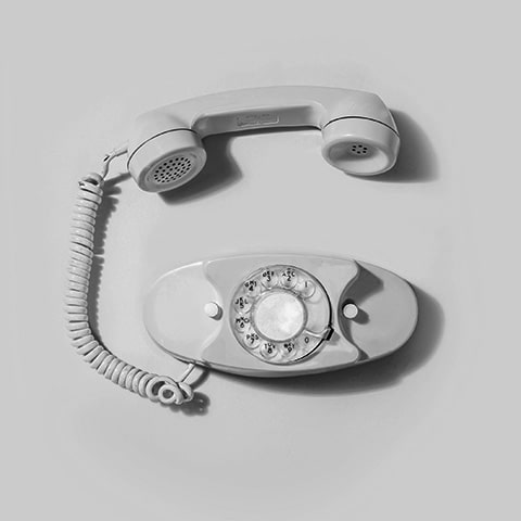 Black and white photo of an old-fashioned landline telephone.