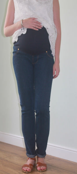 Dark blue slim fit fashionably pregnant over the bump jeans