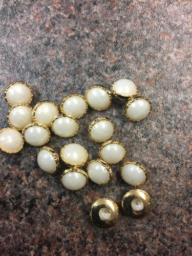 Gold pearl faced round buttons