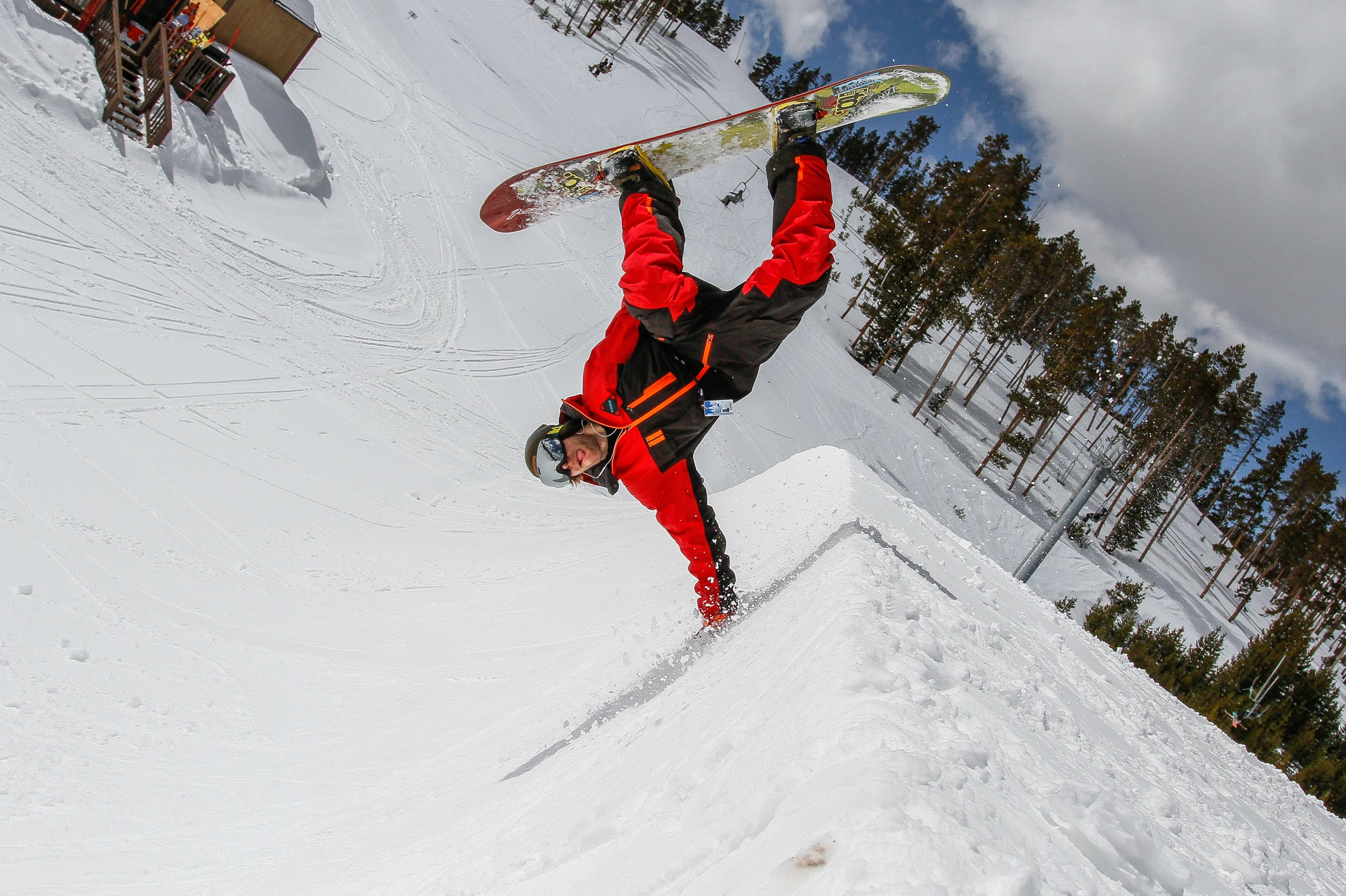 Ricky Bates snowboarding in the Tiro Mono Suit