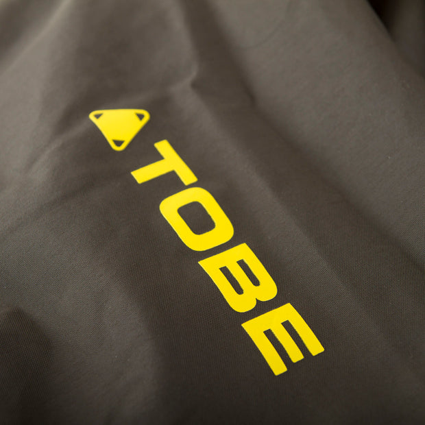 TOBE Tiro Insulated Mono Suit, Dark Ink - Logo Detail
