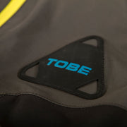 TOBE Tiro Insulated Mono Suit, Dark Ink - Carabiner Crest Detail