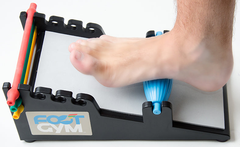 man using the massage on the foot gym