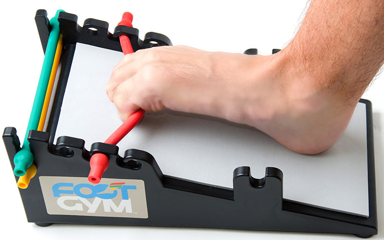man using the tow curl on the foot gym