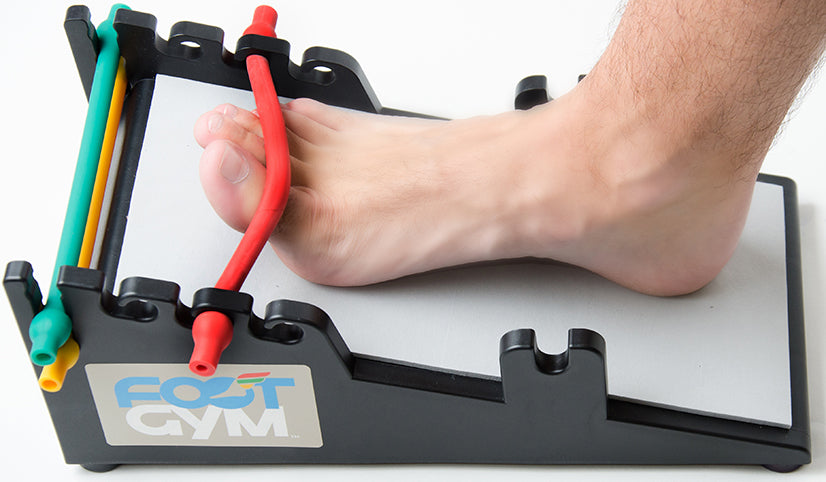 man using the tow flex on the foot gym