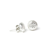 silver shroom studs on white background