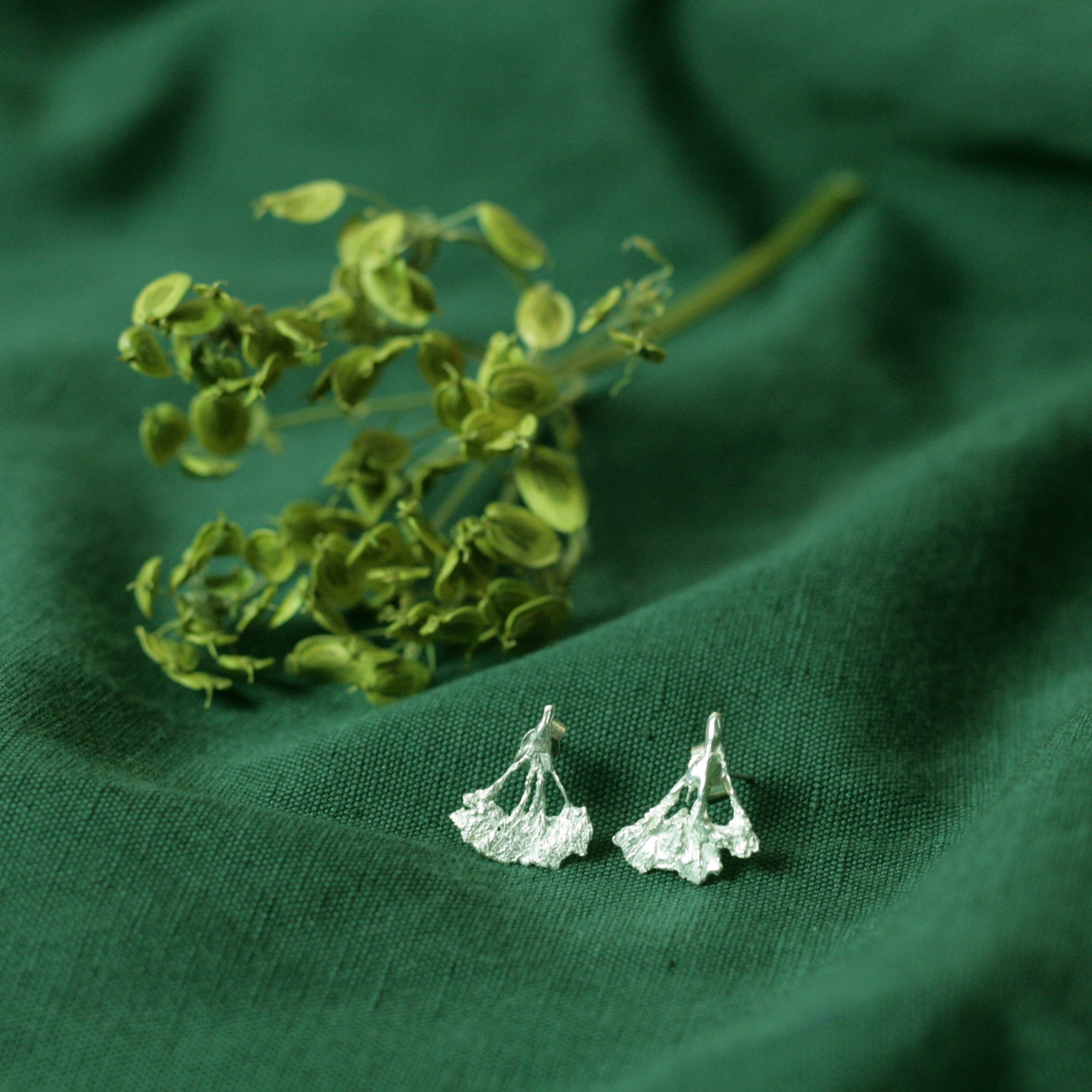 cow parsley silver earrings on green cloth with dried flowers