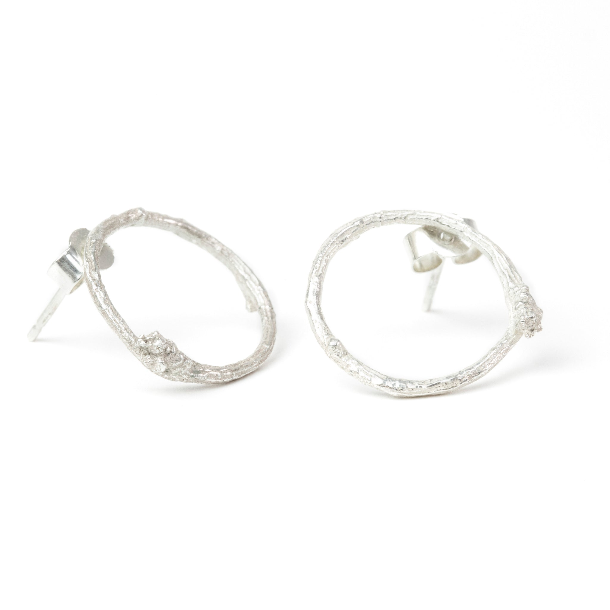 Silver Twig Circle Stud Earrings on white background