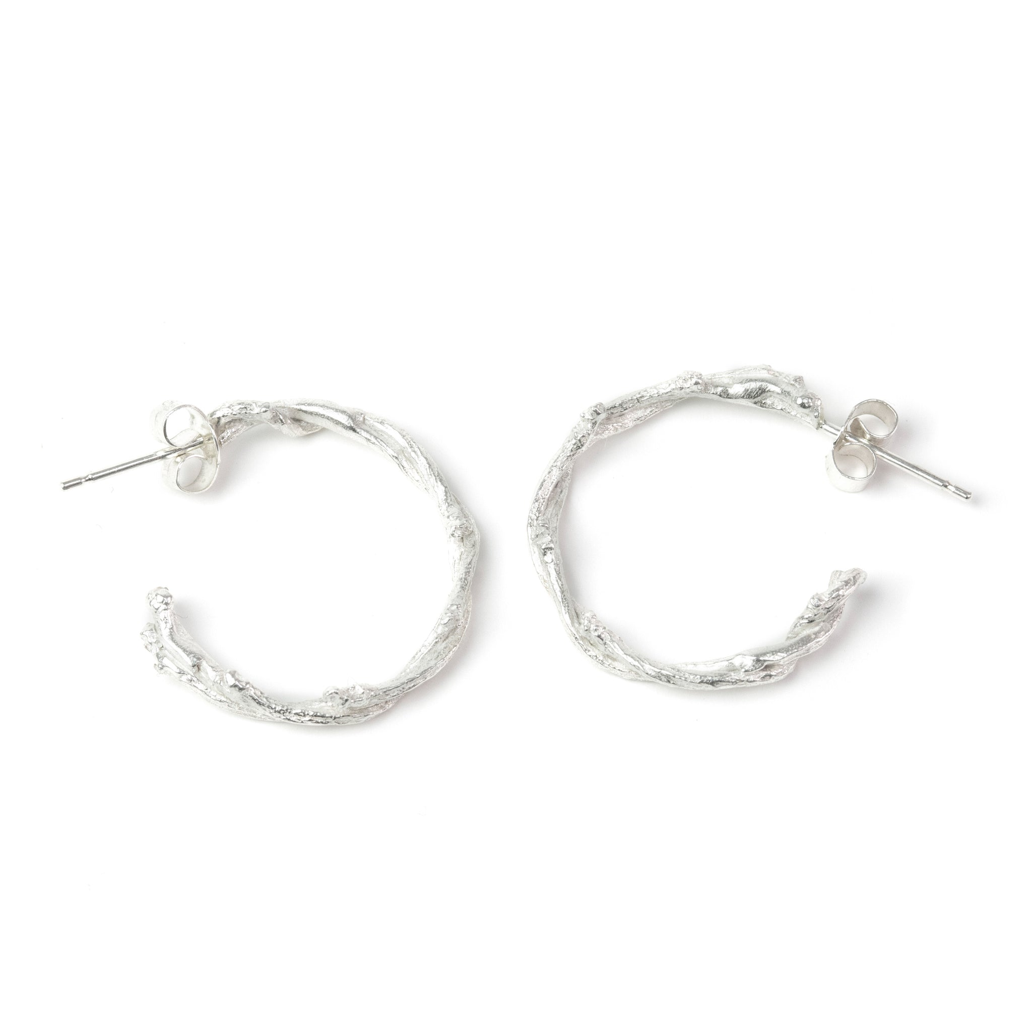 Silver Twisted Twig Hoops on white background
