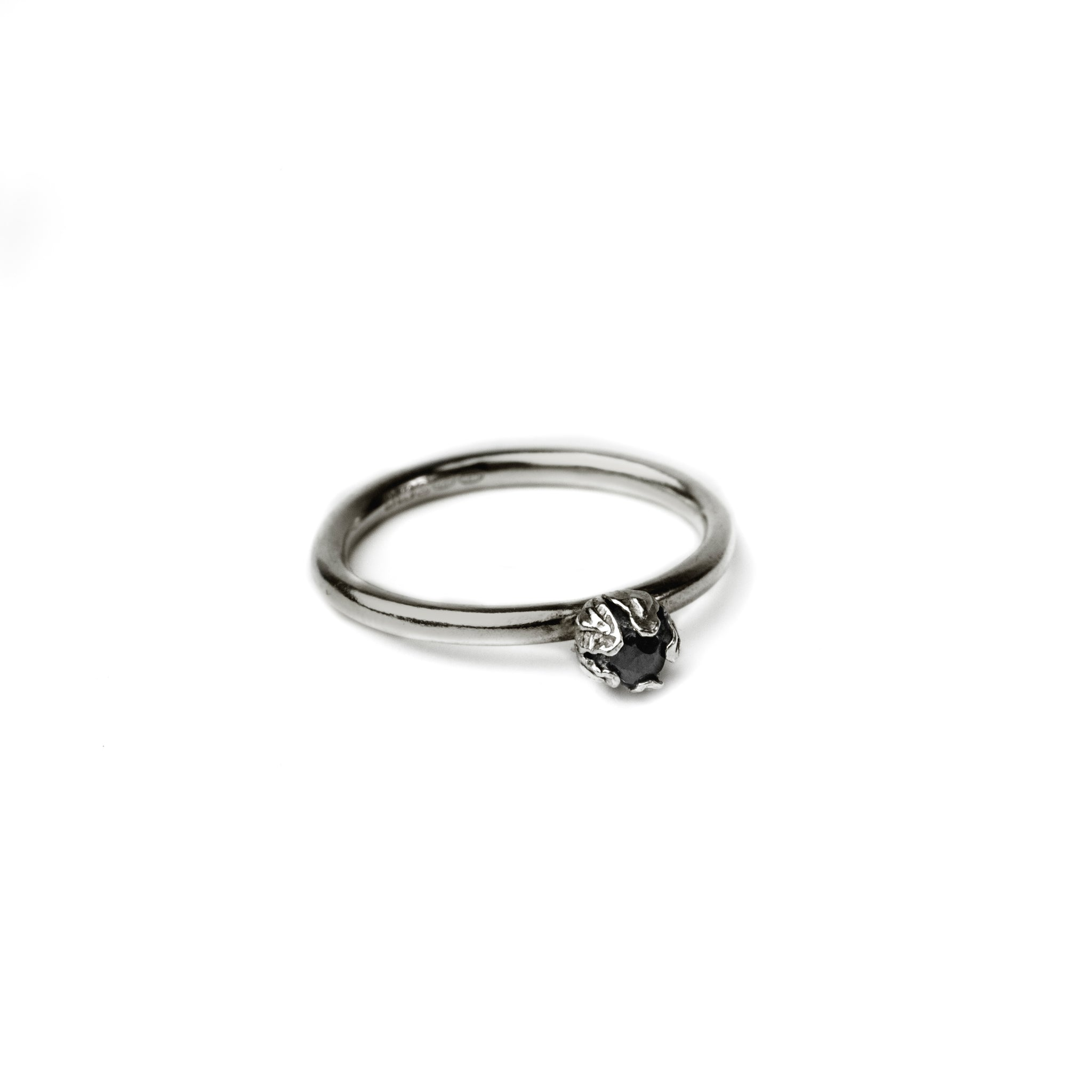 oxidised bud diamond ring on white background