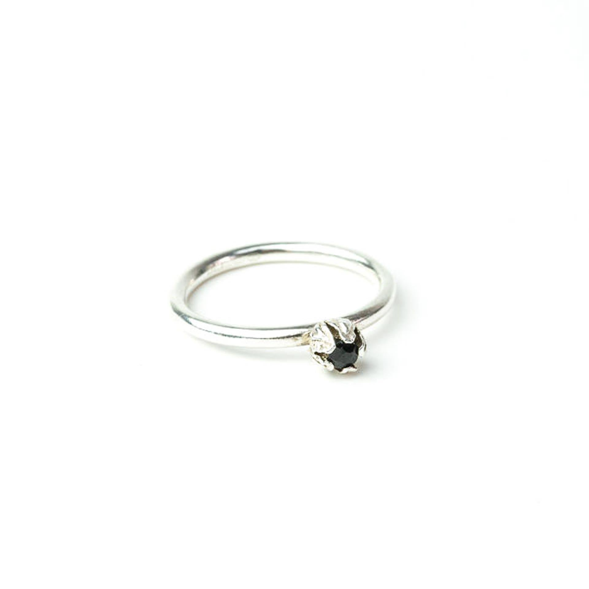 silver bud diamond ring on white background