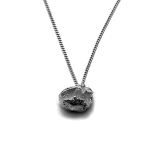 oxidised hazelnut necklace on white background
