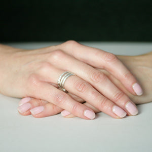 ivy leaf stacking rings on hands