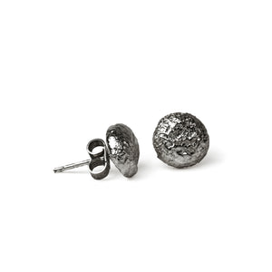 oxidised shroom studs on white background