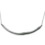 oxidised smooth twig necklace on white background