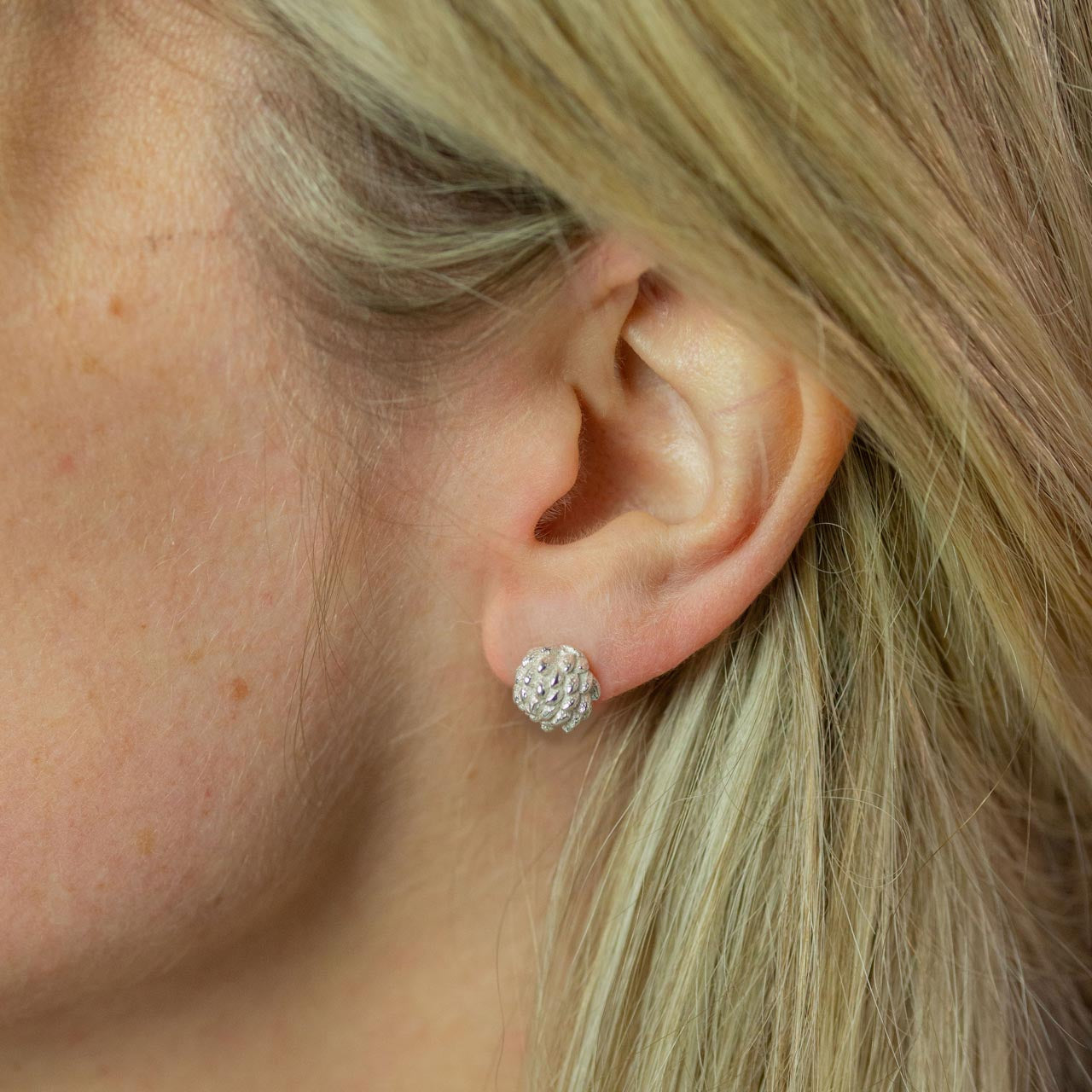 ear modelling silver buttercup stud earrings