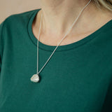 silver hazelnut necklace modelled on green shirt