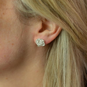 Silver Hedgerow Flower stud earrings modelled on ear