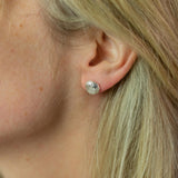 silver shroom studs modelled on ear