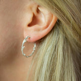 Silver Twisted Twig Hoops modelled in ear