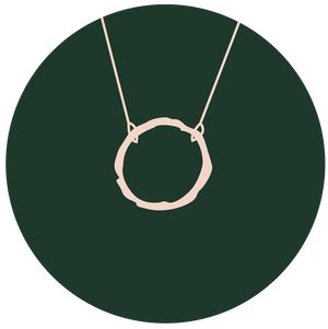 illustration of single eternity necklace on green circle background