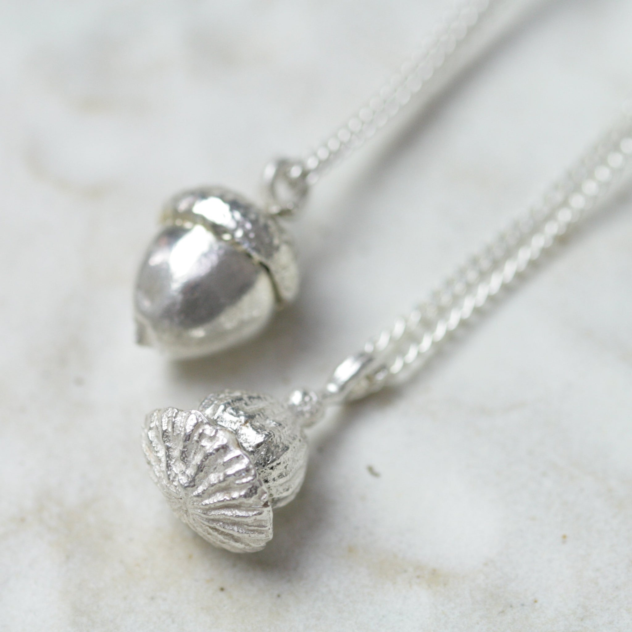 Encapsulated Poppy seed memory pendant