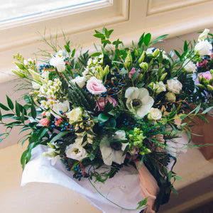 wedding bouquet near window