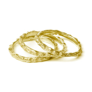 gold scattered seed rings on white background