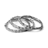 oxidised scattered seed rings on white background