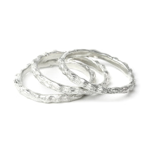 silver scattered seed rings on white background