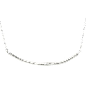 silver smooth twig necklace on white background