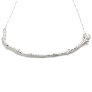 Silver Textured Twig Necklace on white background