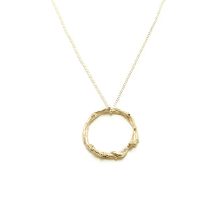 gold wreath pendant on white background