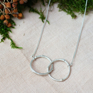 Double circle twig necklace hand made silver pendant inspired by nature