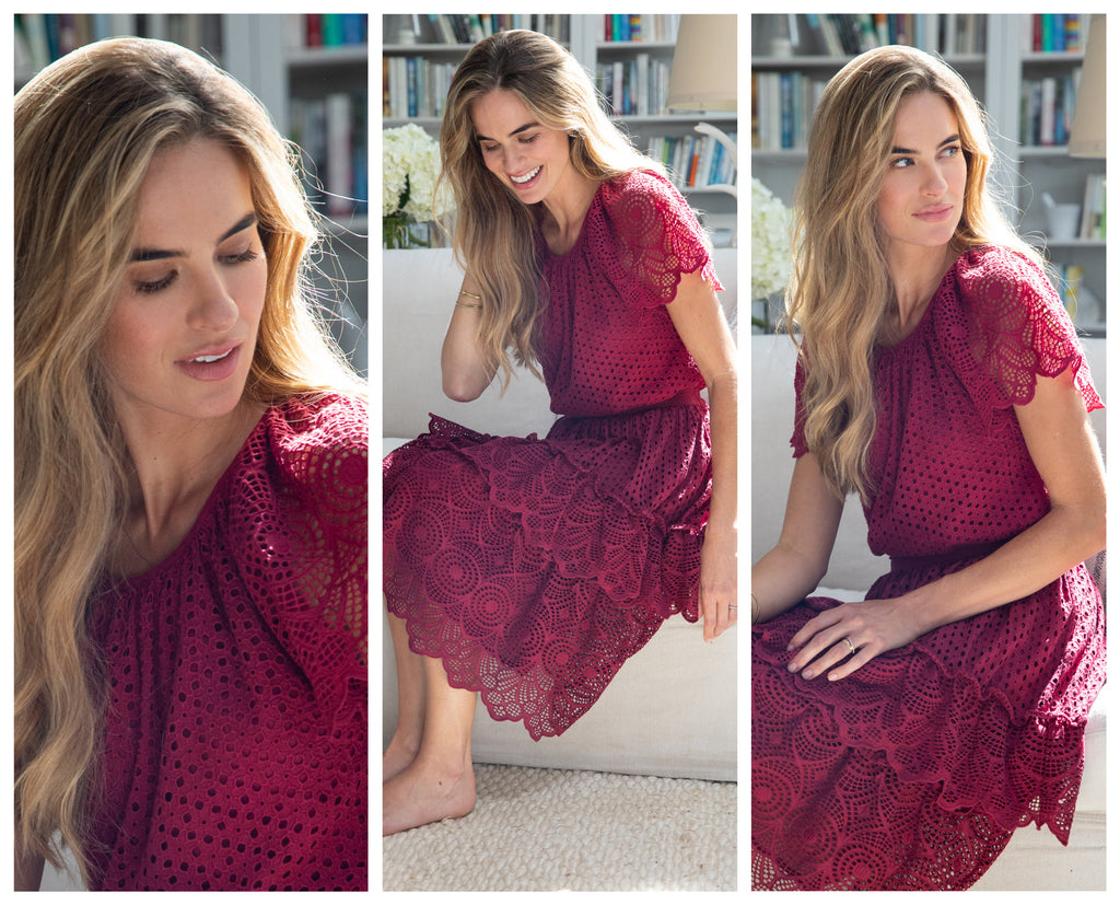 Three images of a woman in a cranberry, eyelet top and skirt. The first image is a closeup image of her face looking down. The second and third image are of her sitting on a sofa in the cranberry outfit.