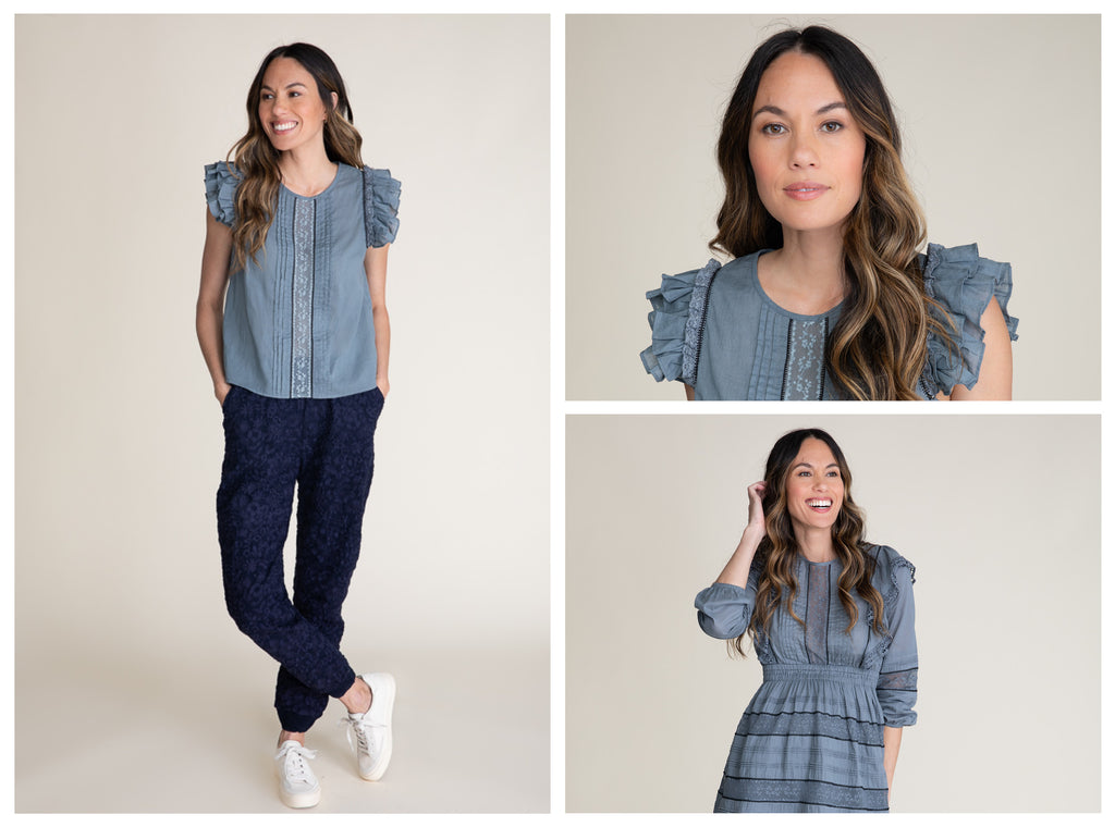 Three collaged images of a brunette woman. The first image she is wearing navy embroidered pants with her legs crossed and a blue gray cotton top with lace inserts, pintucks and flutter sleeves. The second image is close up of her face and shes wearing a blue gray cotton top with lace inserts pintucks and flutter sleeves. In the bottom right image she has her hand in her hair and is smiling towards off camera. She is wearing a blue gray dress with lace inserts, pintucks and an elastic waistband.