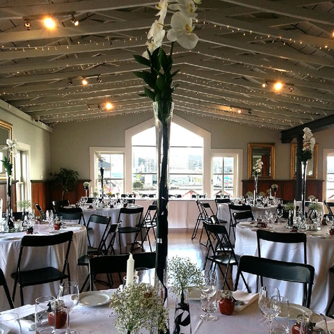 Boatshed wellington venue for weddings or parties with white flower decorations