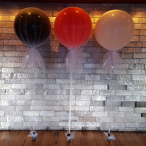 Black red and white helium balloon decorations with tule inside The Establishment venue in Wellington