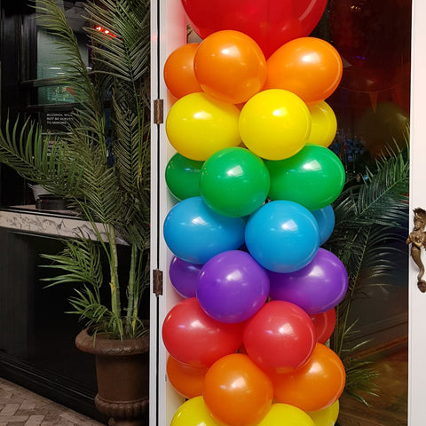 Colourful rainbow pride parade balloon column decorations at the garden hotel venue in Wellington