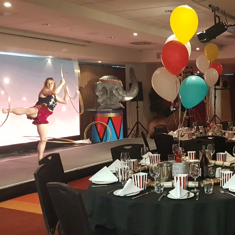 Colourful balloon bouquet decor inside circus themed function at The Rydges hotel in Wellington