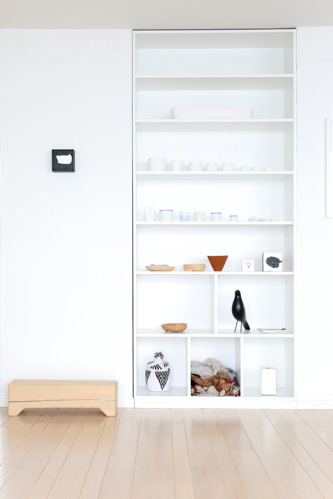 Modern, minimalist open shelving with artwork of Tina Frey and objects of art in Faunamade blog post